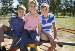 Portrait of three young brothers sitting on a merry go round in a parkhttp://195.154.178.81/DATA/i_collage/pi/shoots/782465.jpg